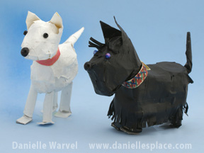 Dog Newspaper and Tape Sculpture www.daniellesplace.com