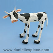 Newspaper and Masking Tape cow Craft www.daniellesplace.com