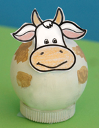 cow made from a wooden ball and bottle cap  from www.daniellesplace.com