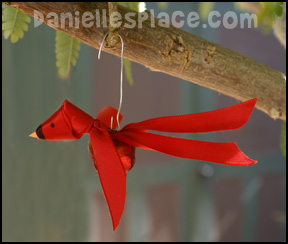 Red Bird Christmas Ornament Craft - Ribbon and Bell Cardinal Craft for Kids from www.daniellesplace.com