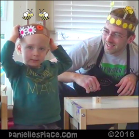 Logan Makes a Bee Hat Craft with his Dad - Toddler-tested Craft from www.daniellesplace.com