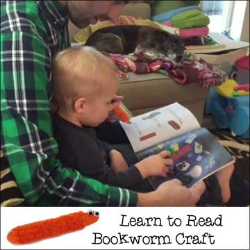 Logan uses his bookworm pointer craft to read books with his dad  - Find out how to make this craft on www.daniellesplace.com