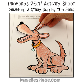 Proverbs 26:17 - Grabbing a stray dog by the Ears Bible lesson about Fighting on Daniellesplace.com